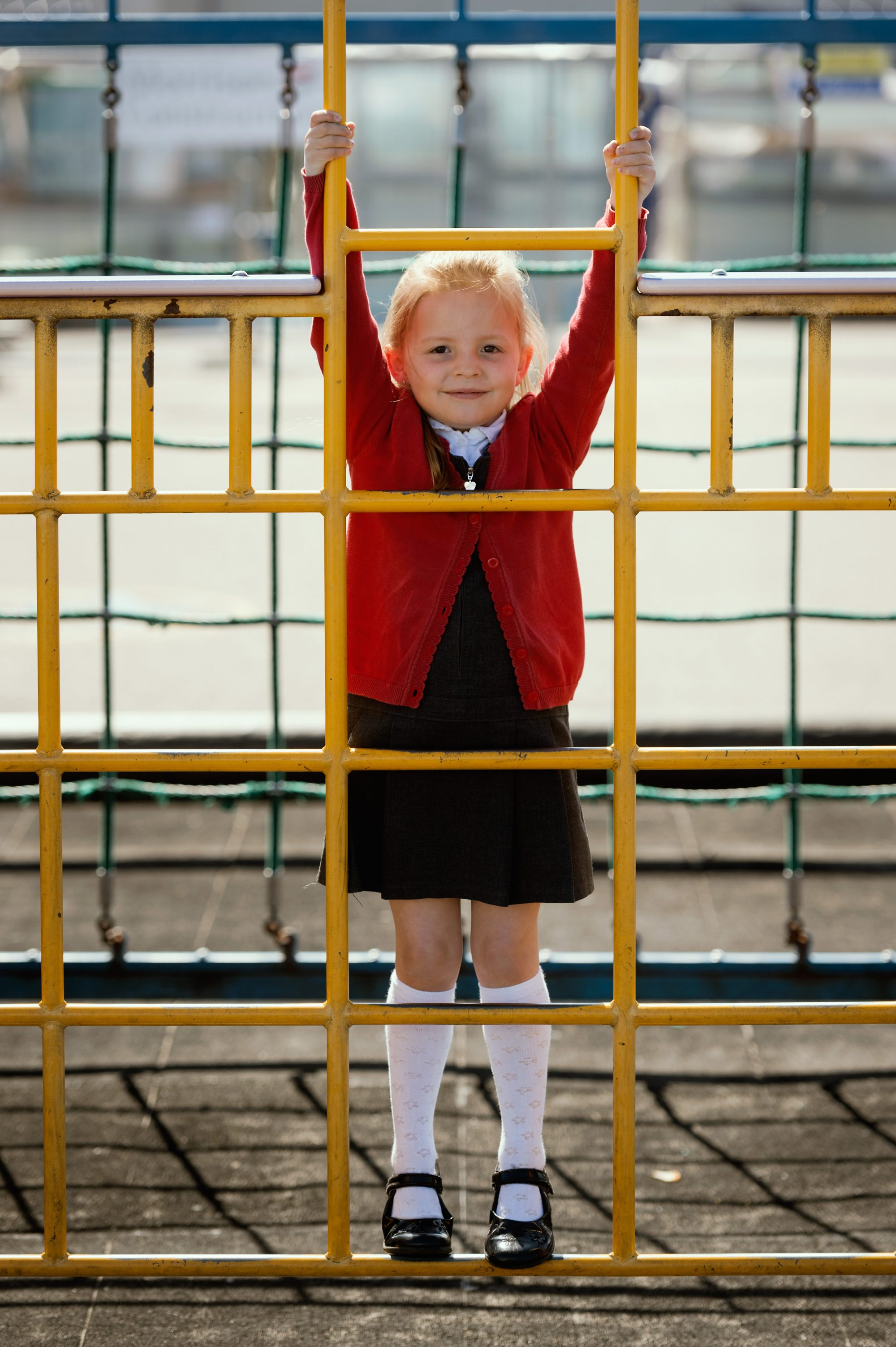 Girl on climbing frame, St Geraldine's Primary, Lossiemouth