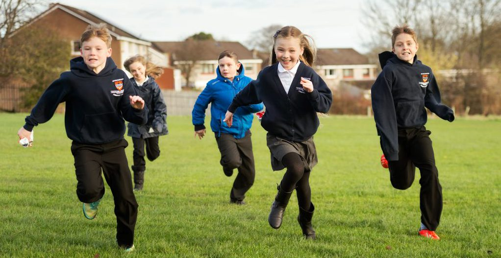 Pupils running on grass, Maurice wood Primary School, Penicuik