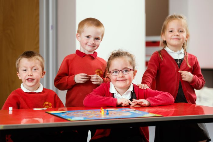 Pupils from St. Geraldine Primary playing a board game