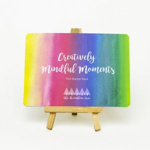 Creatively Mindful Moments cover card on an easel