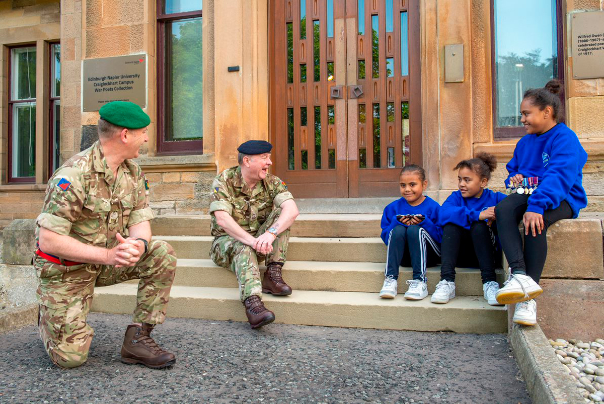 Personnel Recovery Officer Neil Davies and Officer Commanding Del Hamilton at Scotland and Northern Ireland Personnel Recovery Centre, with Samantha, Bella & Alice Kedrayate