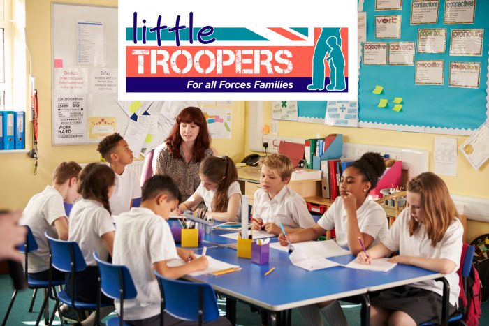 A group of school aged young people with the Little Troopers logo overlaid