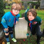 Alfie and Archie by a war memorial