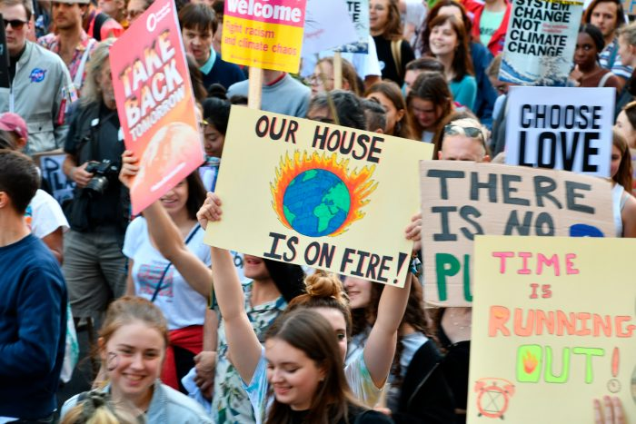 A crowd of young people at a climate protest